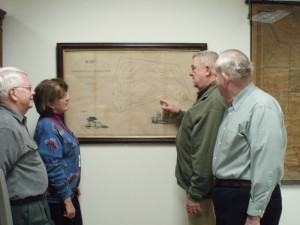 Trustees present cemetery map to public library